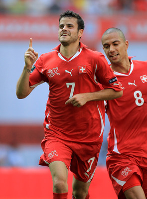 LONDON, ENGLAND - JUNE 04:  Tranquillo Barnetta of Switzerland (L) celebrates scoring the first goal with teammate Gokhan Inler during the UEFA EURO 2012 group G qualifying match between England and Switzerland at Wembley Stadium on June 4, 2011 in London