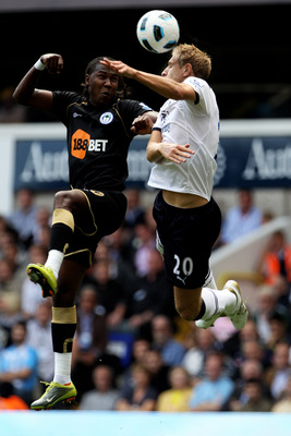 LONDON, ENGLAND - AUGUST 28:  Michael Dawson of Tottenham battles for the header with Hugo Rodallega of Wigan during the Barclays Premier League match between Tottenham Hotspur and Wigan Athletic at White Hart Lane on August 28, 2010 in London, England.