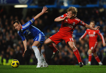 LONDON, ENGLAND - FEBRUARY 06:  John Terry of Chelsea battles Dirk Kuyt of Liverpool during the Barclays Premier League match between Chelsea and Liverpool at Stamford Bridge on February 6, 2011 in London, England.  (Photo by Laurence Griffiths/Getty Imag