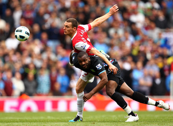LONDON, ENGLAND - MAY 15:  Thomas Vermaelen (L) of Arsenal in action against Darren Bent of Aston Villa during the Barclays Premier League match between Arsenal and Aston Villa at the Emirates Stadium on May 15, 2011 in London, England.  (Photo by Richard