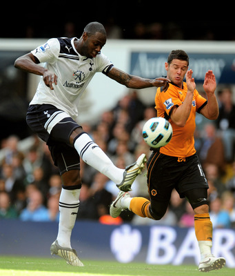 LONDON, ENGLAND - SEPTEMBER 18:  Ledley King of Spurs clears the ball as Matt Jarvis of Wolves closes in during the Barclays Premier League match between Tottenham Hotspur and Wolverhampton Wanderers at White Hart Lane on September 18, 2010 in London, Eng