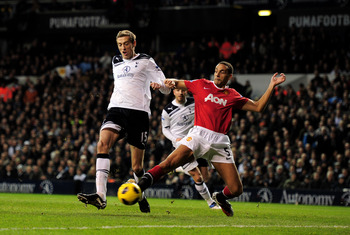 LONDON, ENGLAND - JANUARY 16:  Peter Crouch of Spurs is tackled by Rio Ferdinand of Manchester United during the Barclays Premier League match between Tottenham Hotspur and Manchester United at White Hart Lane on January 16, 2011 in London, England.  (Pho