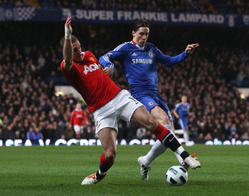 LONDON, ENGLAND - MARCH 01: Fernando Torres of Chelsea challenges Nemanja Vidic of Manchester United during the Barclays Premier League match between Chelsea and Manchester United at Stamford Bridge on March 1, 2011 in London, England.  (Photo by Clive Ro