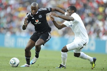 JOHANNESBURG, SOUTH AFRICA - JULY 23:  Mark Mayambela of Pirates and Sebastien Bassong of Tottenham in action during the 2011 Vodacom Challenge final match between Orlando Pirates and Tottenham Hotspur at Coca Cola Stadium on July 23, 2011 in Johannesburg
