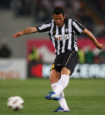 ROME, ITALY - APRIL 03:   Fabio Grosso  of Juventus FC kicks the ball during the Serie A match between AS Roma and Juventus FC at Stadio Olimpico on April 3, 2011 in Rome, Italy.  (Photo by Paolo Bruno/Getty Images)