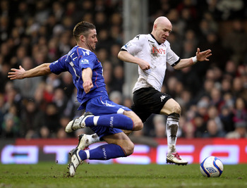 LONDON, ENGLAND - FEBRUARY 20:  Gary Cahill (L) of Bolton tackles Andrew Johnson of Fulham during the FA Cup sponsored by E.ON 5th Round match between Fulham and Bolton Wanderers at Craven Cottage on February 20, 2011 in London, England.  (Photo by Paul G