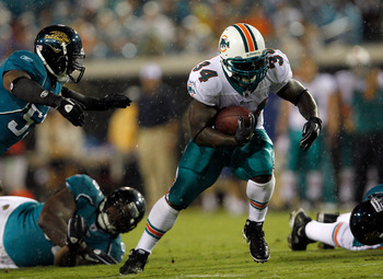 JACKSONVILLE, FL - AUGUST 21:  Ricky Williams #34 of the Miami Dolphins runs for yardage during the preseason game against the Jacksonville Jaguars at EverBank Field on August 21, 2010 in Jacksonville, Florida.  (Photo by Sam Greenwood/Getty Images)