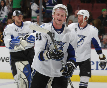 VANCOUVER, CANADA - DECEMBER 11:  Steven Stamkos #91 of the Tampa Bay Lighting smiles after scoring the overtime winning goal during their game against the Vancouver Canucks at Rogers Arena on December 11, 2010 in Vancouver, British Columbia, Canada.  Tam