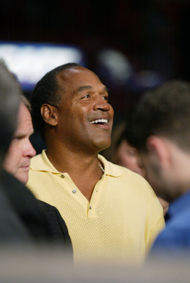 02 Feb 2002:   OJ Simpson sits in the audience during the Lightheavyweight bout bewteen Roy Jones Jr and Glen Kelly at American Airlines Arena in Miami, Florida. Roy Jones Jr. won by KO in the 7th. DIGITAL IMAGE. Mandatory Credit: Eliot Schechter/Getty Im