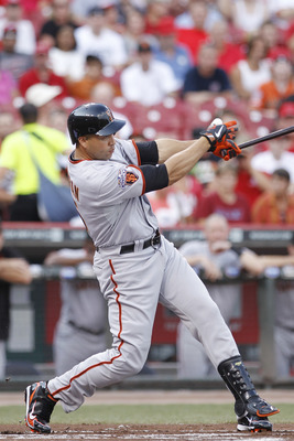 CINCINNATI, OH - JULY 29: Carlos Beltran #15 of the San Francisco Giants singles to drive in a run in the first inning against the Cincinnati Reds at Great American Ball Park on July 29, 2011 in Cincinnati, Ohio. (Photo by Joe Robbins/Getty Images)