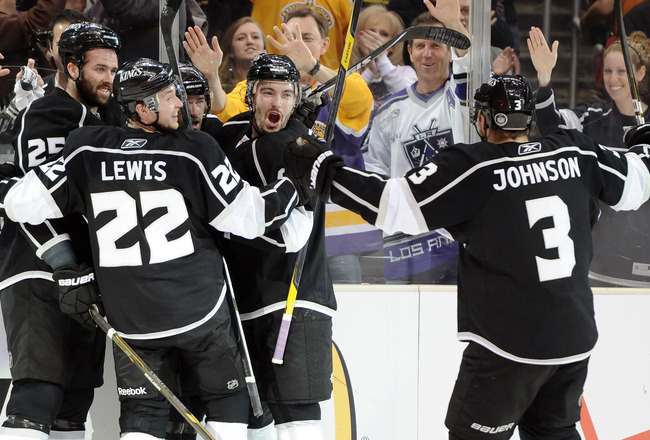 LOS ANGELES, CA - APRIL 25:   The Los Angeles Kings celebrate after a goal by Justin Williams #14 against the San Jose Sharks in the second period of game six of the Western Conference Quarterfinals during the 2011 NHL Stanley Cup Playoffs at Staples Cent