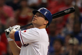 ARLINGTON, TX - JULY 28:  Chris Davis #19 of the Texas Rangers hits an RBI single against the Minnesota Twins at Rangers Ballpark in Arlington on July 28, 2011 in Arlington, Texas.  (Photo by Ronald Martinez/Getty Images)