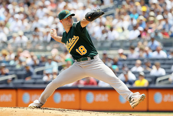 NEW YORK, NY - JULY 23:  Rich Harden #18 of the Oakland Athletics delivers a pitch against the New York Yankees on July 23, 2011 at Yankee Stadium in the Bronx borough of New York City.  (Photo by Jim McIsaac/Getty Images)