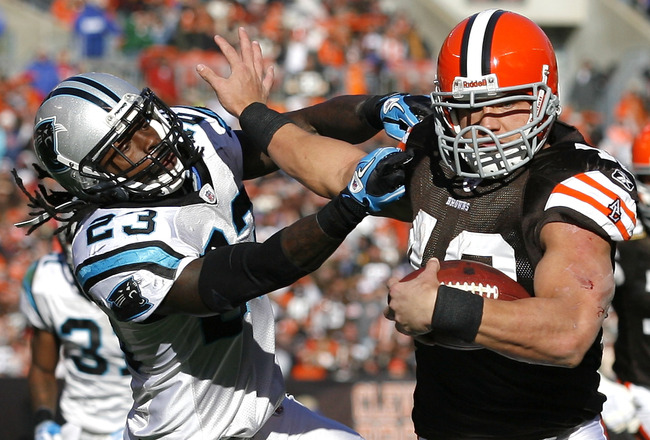 CLEVELAND - NOVEMBER 28:  Running back Peyton Hillis #40 of the Cleveland Browns scores a touchdown as he runs from safety Sherrod Martin #23 of the Carolina Panthers at Cleveland Browns Stadium on November 28, 2010 in Cleveland, Ohio.  (Photo by Matt Sul