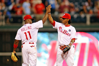 PHILADELPHIA, PA - JULY 29:  Jimmy Rollins #11 and Michael Martinez #19 of the Philadelphia Phillies celebrates a 10-3 win over the Pittsburgh Pirates at Citizens Bank Park on July 29, 2011 in Philadelphia, Pennsylvania.  (Photo by Len Redkoles/Getty Imag