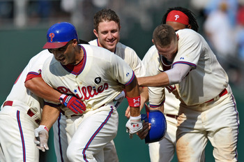 PHILADELPHIA, PA - JULY 31: Raul Ibanez #29 of the Philadelphia Phillies is congratulated by teammates (L-R) Carlos Ruiz #51, Chase Utley #26, Hunter Pence #3 and Michael Martinez #19 after hitting a walk off double in the 10th inning to beat the Pittsbur