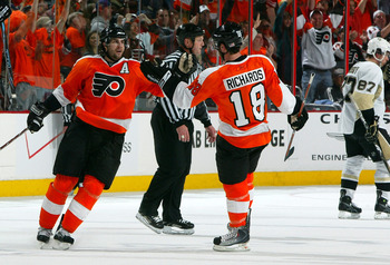 PHILADELPHIA - APRIL 19:  Simon Gagne #12 and Mike Richards #18 of the Philadelphia Flyers celebrate a third period goal against the Pittsburgh Penguins during Game Three of the Eastern Conference Quarterfinal Round of the 2009 NHL Stanley Cup Playoffs  a