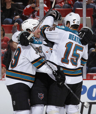 DETROIT - MAY 6: Dany Heatley #15 of the San Jose Sharks celebrates a third period goal with Jan Mursak #39 while playing the Detroit Red Wings in Game Four of the Western Conference Semifinals during the 2011 NHL Stanley Cup Playoffs on May 6, 2011 at Jo