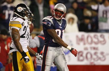 FOXBORO, MA - DECEMBER 9:   Randy Moss #81 of the New England Patriots reacts as he walks by Anthony Smith #27 of the Pittsburgh Steelers after a penalty was called in the third quarter at Gillette Stadium December 9, 2007 in Foxboro, Massachusetts. The P