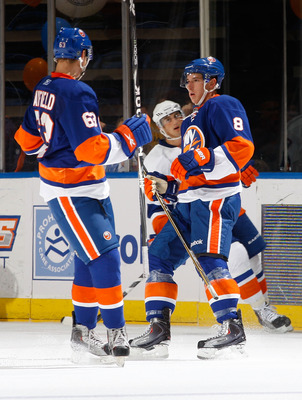 UNIONDALE, NY - JULY 16: Ryan Strome #8 of the New York Islanders celebrates a goal with teammate Scott Mayfield #63 during the Blue v White Game on July 16, 2011 at Nassau Coliseum in Uniondale, New York. (Photo by Mike Stobe/Getty Images)