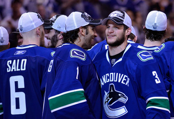 VANCOUVER, CANADA - MAY 24:  Goaltender Roberto Luongo #1 and Kevin Bieksa #3 of the Vancouver Canucks celebrate after defeating the San Jose Sharks 3-2 in double-overtime in Game Five to win the Western Conference Finals during the 2011 Stanley Cup Playo