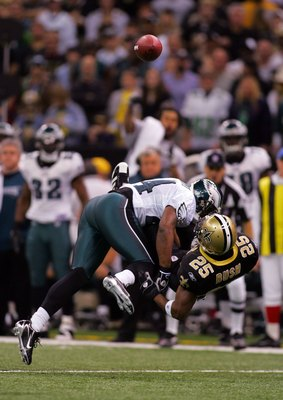 NEW ORLEANS - JANUARY 13:  Sheldon Brown #24 of the Philadelphia Eagles breaks up a pass intended for Reggie Bush #25 of the New Orleans Saints during the NFC divisional playoff game at the Superdome on January 13, 2007 in New Orleans, Louisiana.  (Photo