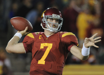 LOS ANGELES, CA - OCTOBER 30: Matt Barkley #7 of the USC Trojans passes in the pocket against the Oregon Ducks during the second quarter at Los Angeles Memorial Coliseum on October 30, 2010 in Los Angeles, California.  (Photo by Harry How/Getty Images)