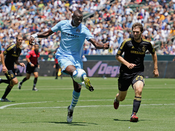 CARSON, CA - JULY 24:  Mario Balotelli #45 of Manchester City attempts a shot on goal against Kyle Davies #29 Los Angeles during the Herbalife World Football Challenge 2011 at the Home Depot Center on July 24, 2011 in Carson, California.  (Photo by Kevork