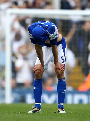 LONDON, ENGLAND - MAY 22:  Roger Johnson of Birmingham City bows his head after Birmingham were relegated during the Barclays Premier League match between Tottenham Hotspur and Birmingham City at White Hart Lane on May 22, 2011 in London, England.  (Photo