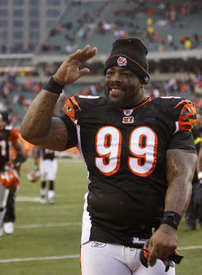 CINCINNATI - DECEMBER 27:  Tank Johnson #99 of the Cincinnati Bengals celebrates defeating the Kansas City Chiefs in their NFL game at Paul Brown Stadium December 27, 2009 in Cincinnati, Ohio.    (Photo by John Sommers II/Getty Images)