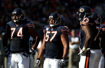 CHICAGO - OCTOBER 17: (L-R) Chris Williams #74, Olin Kreutz #57 and J'Marcus Webb #73 of the Chicago Bears wait in the huddle against the Seattle Seahawks at Soldier Field on October 17, 2010 in Chicago, Illinois. The Seahawks defeated the Bears 23-20. (P