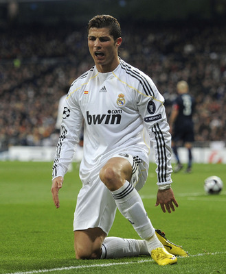 MADRID, SPAIN - MARCH 10:  Cristiano Ronaldo  of Real Madrid reacts during the UEFA Champions League round of 16 2nd leg match between  Real Madrid and Olympique Lyonnais at Estadio Santiago Bernabeu on March 10, 2010 in Madrid, Spain.  (Photo by Denis Do