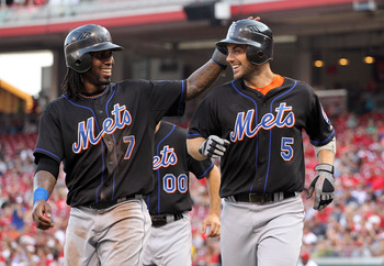 CINCINNATI, OH - JULY 27:  Jose Reyes #7 and David Wright #5 of the New York Mets celebrate after scoring in the first inning during the game against the Cincinnati Reds at Great American Ball Park on July 27, 2011 in Cincinnati, Ohio.  (Photo by Andy Lyo