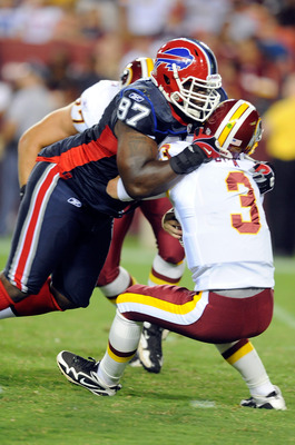 LANDOVER, MD - AUGUST 13:  John Beck #3 of the Washington Redskins is sacked during the preseason game by John McCargo #97 of the Buffalo Bills at FedEx Field on August 13, 2010 in Landover, Maryland.  (Photo by Greg Fiume/Getty Images)