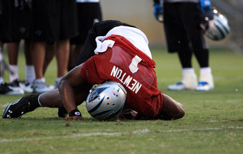 SPARTANBURG, SC - JULY 30:  Cam Newton #1 of the Carolina Panthers is knocked down during training camp at Wofford College on July 30, 2011 in Spartanburg, South Carolina.  (Photo by Streeter Lecka/Getty Images)