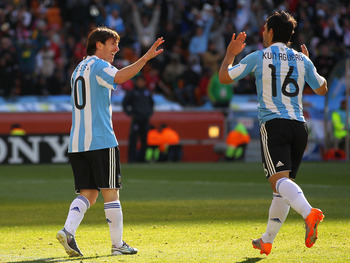 JOHANNESBURG, SOUTH AFRICA - JUNE 17: Lionel Messi of Argentina celebrates with Sergio Aguero of Argentina during the 2010 FIFA World Cup South Africa Group B match between Argentina and South Korea at Soccer City Stadium on June 17, 2010 in Johannesburg,