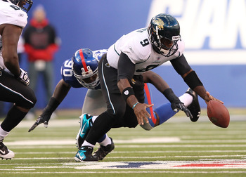 EAST RUTHERFORD, NJ - NOVEMBER 28: David Garrard #9  of the Jacksonville Jaguars fumbles the ball against  the New York Giantsduring their game on November 28, 2010 at The New Meadowlands Stadium in East Rutherford, New Jersey.  (Photo by Al Bello/Getty I