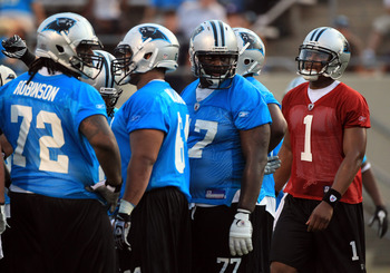 SPARTANBURG, SC - JULY 30:  Cam Newton #1 of the Carolina Panthers goes to the huddle during training camp at Wofford College on July 30, 2011 in Spartanburg, South Carolina.  (Photo by Streeter Lecka/Getty Images)