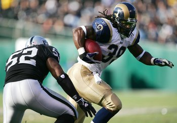 OAKLAND, CA - DECEMBER 17:  Steven Jackson #39 of the St. Louis Rams runs with the ball against Kirk Morrison #52 of the Oakland Raiders on December 17, 2006 at McAfee Coliseum in Oakland, California.   (Photo by Jed Jacobsohn/Getty Images)
