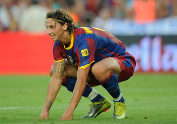 BARCELONA, SPAIN - AUGUST 25:  Zlatan Ibrahimovic of Barcelona gets up during the Joan Gamper Trophy match between Barcelona and AC Milan at Camp Nou stadium on August 25, 2010 in Barcelona, Spain.  (Photo by Denis Doyle/Getty Images)