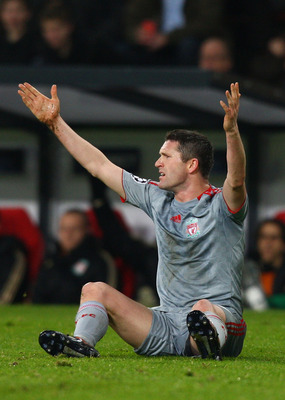 EINDHOVEN, NETHERLANDS - DECEMBER 09:  Robbie Keane of Liverpool appeals for a free kick during the UEFA Champions League Group D match between PSV Eindhoven and Liverpool at the Philips Stadium on December 9, 2008 in Eindhoven, Netherlands.  (Photo by Ry