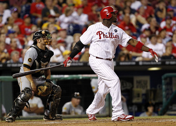 PHILADELPHIA, PA- JULY 30: Ryan Howard #6 of the Philadelphia Phillies watches a long double in front of Michael McKenry #55 of the Pittsburgh Pirates at Citizens Bank Park on July 30, 2011 in Philadelphia, Pennsylvania.  (Photo by Jeff Zelevansky/Getty I
