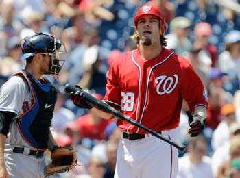 WASHINGTON, DC - JULY 31: Jayson Werth #28 of the Washington Nationals walks past catcher Josh Thole #30 of the New York Mets after striking out during the second inning at Nationals Park on July 31, 2011 in Washington, DC.  (Photo by Rob Carr/Getty Image