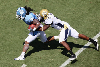 CHAPEL HILL, NC - SEPTEMBER 18:  Brandon Watts #11 of the Georgia Tech Yellow Jackets tackles Johnny White #34 of the North Carolina Tar Heels during their game at Kenan Stadium on September 18, 2010 in Chapel Hill, North Carolina.  (Photo by Streeter Lec