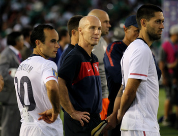 PASADENA, CA - JUNE 25:  Head coach Bob Bradley, Clint Dempsey #8, and Landon Donovan #10 of the United States wait for the award ceremony after the game with Mexico during the 2011 CONCACAF Gold Championship at the Rose Bowl on June 25, 2011 in Pasadena,
