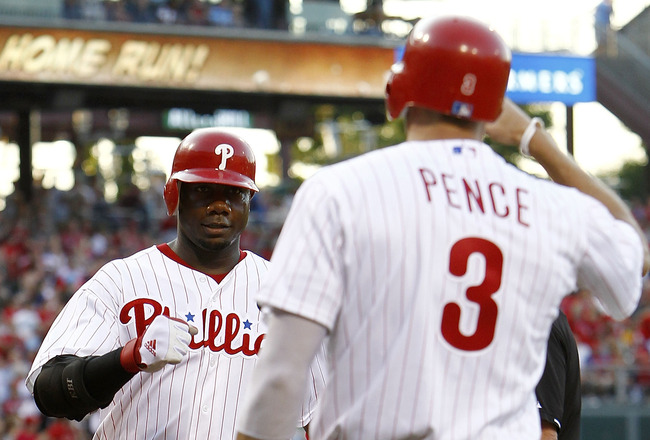 PHILADELPHIA, PA- JULY 30:  Hunter Pence #3 greets Ryan Howard #6 of the Philadelphia Phillies on his solo home run against the Pittsburgh Pirates at Citizens Bank Park on July 30, 2011 in Philadelphia, Pennsylvania.  (Photo by Jeff Zelevansky/Getty Image