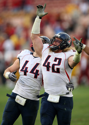 LOS ANGELES - DECEMBER 5:  Defensive ends Brooks Reed #42 and Ricky Elmore #44 of the Arizona Wildcats celebrate after stopping the USC Trojans on the final play on December 5, 2009 at the Los Angeles Coliseum in Los Angeles, California. Arizona won 21-17