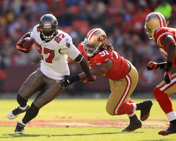 SAN FRANCISCO - NOVEMBER 21:  LeGarrette Blount #27 of the Tampa Bay Buccaneers is tackled by Ray McDonald #91 of the San Francisco 49ers at Candlestick Park on November 21, 2010 in San Francisco, California.  (Photo by Ezra Shaw/Getty Images)