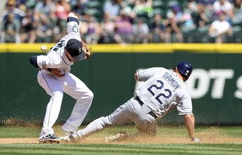 SEATTLE - JULY 30:  Johnny Damon #22 of the Tampa Bay Rays steals second base against shortstop Brendan Ryan #26 of the Seattle Mariners at Safeco Field on July 30, 2011 in Seattle, Washington. (Photo by Otto Greule Jr/Getty Images)