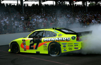 INDIANAPOLIS, IN - JULY 31:  Paul Menard, driver of the #27 NIBCO/Menards Chevrolet, celebrates with a burnout after winning the NASCAR Sprint Cup Series Brickyard 400 at Indianapolis Motor Speedway on July 31, 2011 in Indianapolis, Indiana.  (Photo by Je